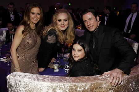 "Oscar winner for best song for ""Skyfall,"" Adele Adkins (C), poses with Kelly Preston (L), actor John Travolta (R) and their daughter Ella Bleu Travolta (front, C) during the Governors Ball for the 85th Academy Awards in Hollywood, California, February 24, 2013. REUTERS/Lucas Jackson"
