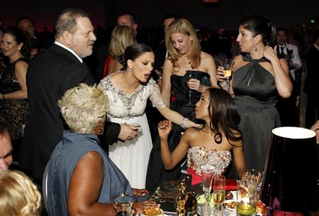 The Weinstein Company Co-Chairman Harvey Weinstein (back L) and wife Georgina Chapman (standing 2nd L) speak to actress Kerry Washington (seated R) at the Governors Ball for the 85th Academy Awards in Hollywood, California February 24, 2013 REUTERS/Lucas Jackson