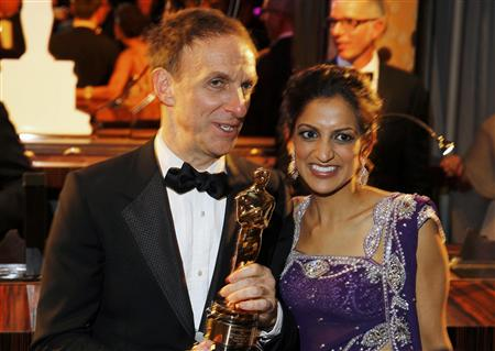 "Canadian composer Mychael Danna holds his Oscar after winning the Best Original Score award for the film ""Life of Pi"", next to his wife Aparna Danna at the Governors Ball following the 85th Academy Awards in Hollywood, California February 24, 2013. REUTERS/Lucas Jackson"