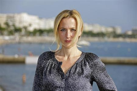 "Actress Gillian Anderson poses during a photocall for the television series ""The Fall"" during the annual MIPCOM television programme market in Cannes, southeastern France, October 8, 2012. REUTERS/Eric Gaillard"