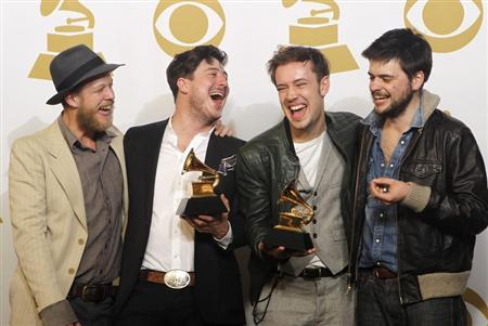 Mumford & Sons pose with their awards for Album of the Year for &quot;Babel&quot; and Best Long Form Music Video for &quot;Big Easy Express&quot; backstage at the 55th annual Grammy Awards in Los Angeles, California February 10, 2013. REUTERS/Mario Anzuoni