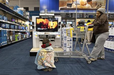 A boy watches television at a Best Buy store in Pineville, North Carolina November 25, 2011. REUTERS/Chris Keane