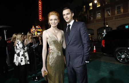 "Cast members Nicholas Hoult and Eleanor Tomlinson pose at the premiere of ""Jack the Giant Slayer"" in Hollywood, California February 26, 2013. REUTERS/Mario Anzuoni"