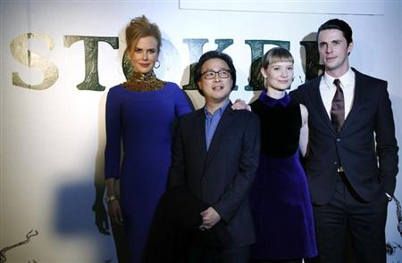 "Actress Nicole Kidman (L), director Park Chan-Wook (2nd L), actress Mia Wasikowska and actor Matthew Goode (R) pose before a screening of the film ""Stoker"" in London February 17, 2013. REUTERS/Luke MacGregor"