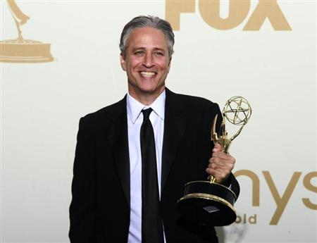"Television host Jon Stewart holds the Emmy award for the ""The Daily Show With Jon Stewart"" after winning for outstanding variety, music or comedy series, backstage at the 63rd Primetime Emmy Awards in Los Angeles September 18, 2011. REUTERS/Lucy Nicholson"