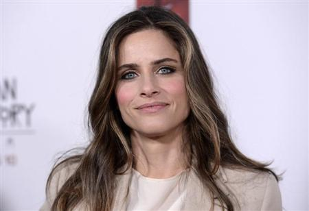 "Actress Amanda Peet attends a premiere screening of ""American Horror Story: Asylum"" in Los Angeles October 13, 2012. REUTERS/Phil McCarten"