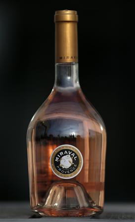 "A bottle of ""Miraval, Cote de Provence"" rose wine is displayed in Paris, March 4, 2013. REUTERS/Christian Hartmann"