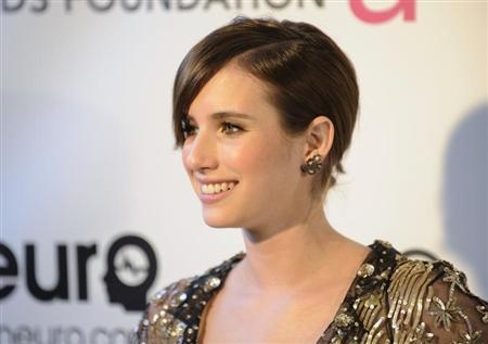 Actress Emma Roberts arrives at the 2013 Elton John AIDS Foundation Oscar Party in West Hollywood, California, February 24, 2013. REUTERS/Gus Ruelas