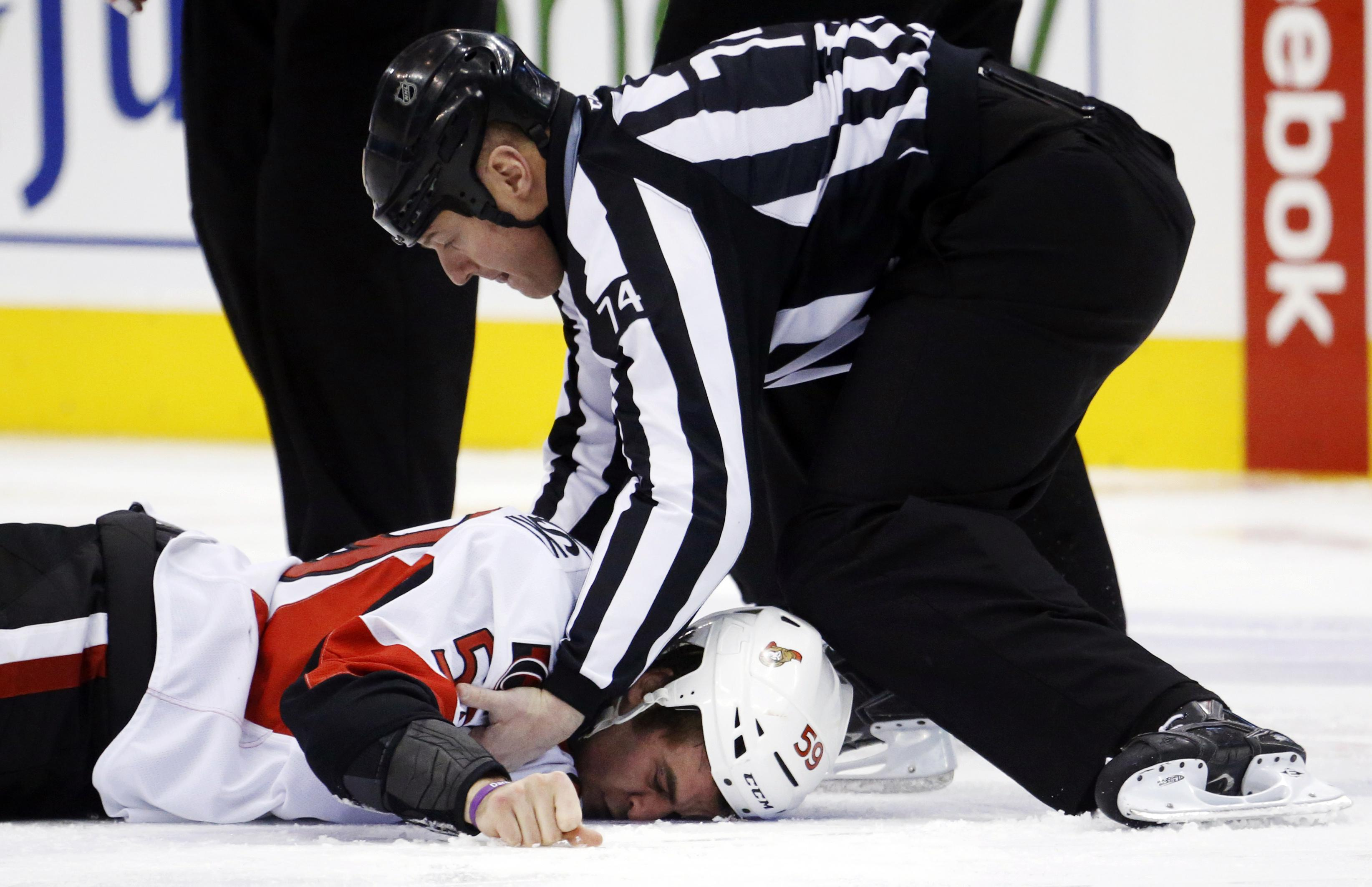 Senators rookie David Dziurzynski was knocked out cold in his first NHL fight. (Reuters)