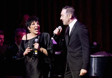 Singer Liza Minnelli and actor Alan Cumming perform during their one night only performance in New York, March 13, 2013. REUTERS/Carlo Allegri