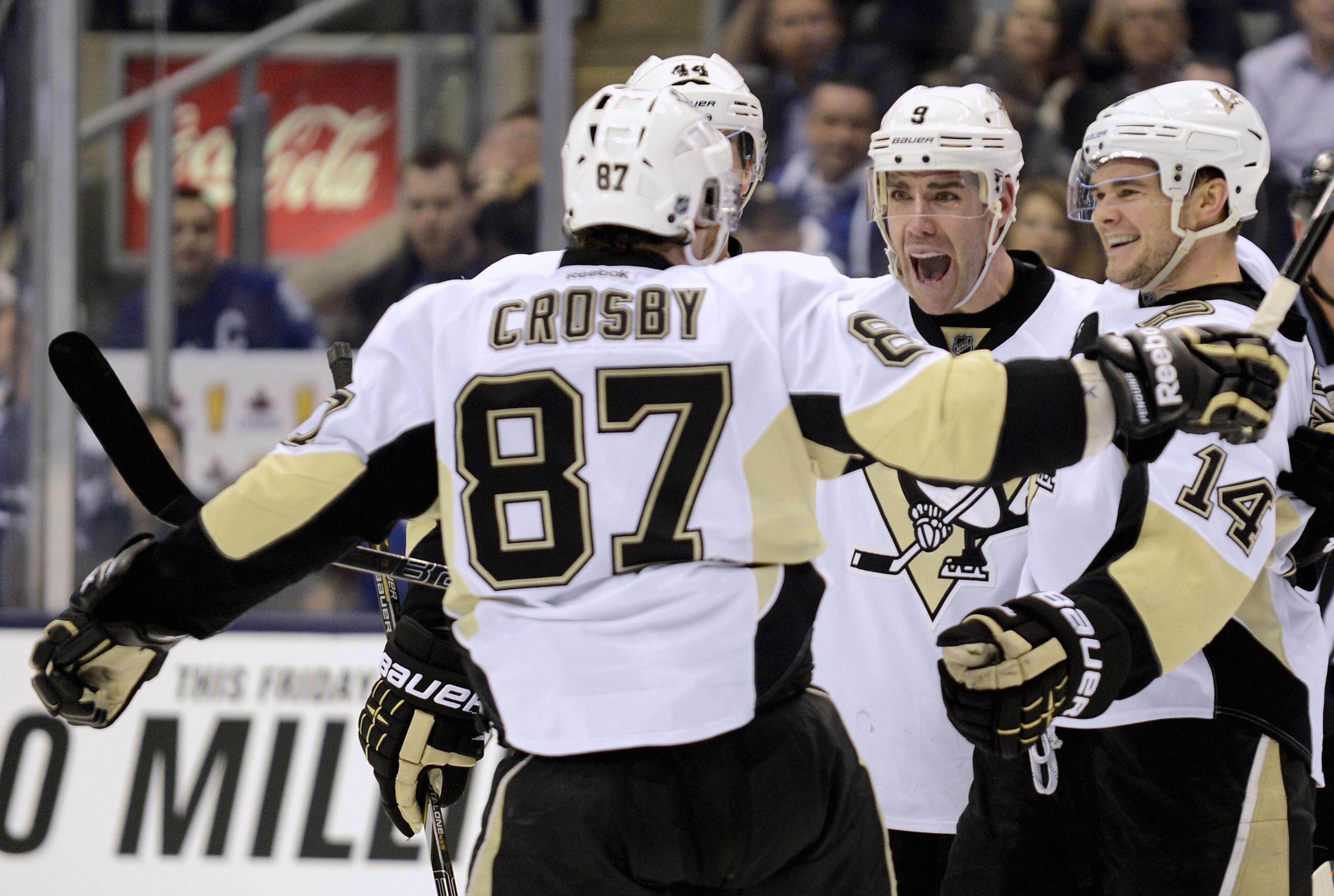 Sidney Crosby knows to make his linemates smile. (Reuters)