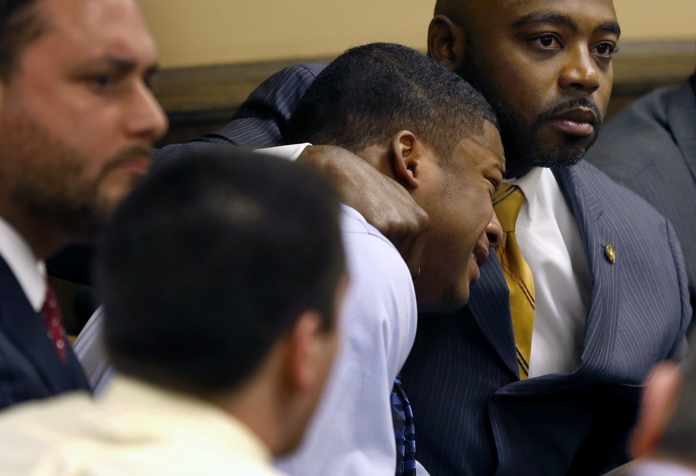 Ma'lik Richmond, center, reacts as the verdict for his and Trent Mays' rape trial is delivered. (Reuters)