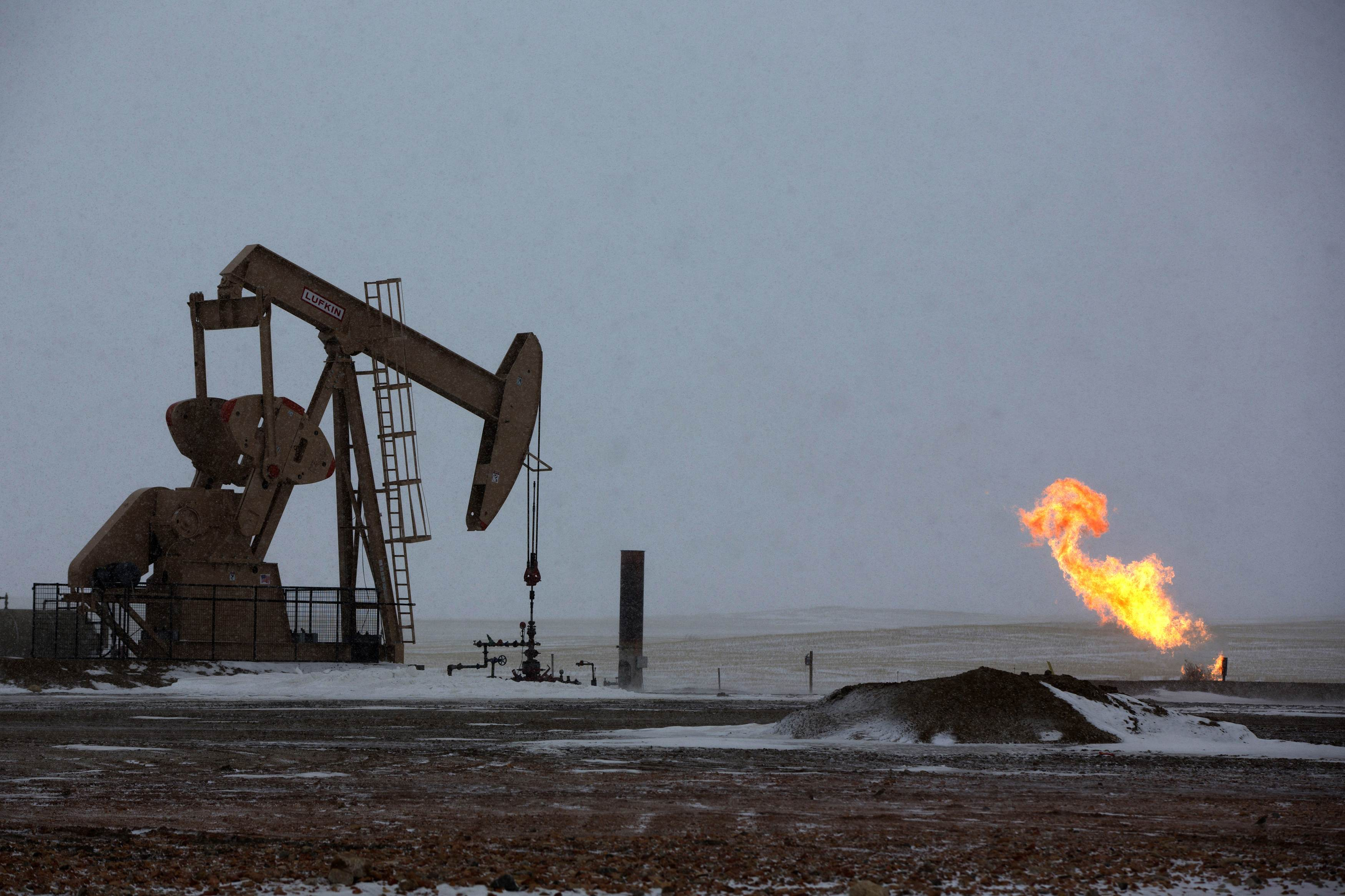 Natural gas flares are seen at an oil pump site outside of Williston, North Dakota. REUTERS/Shannon Stapleton