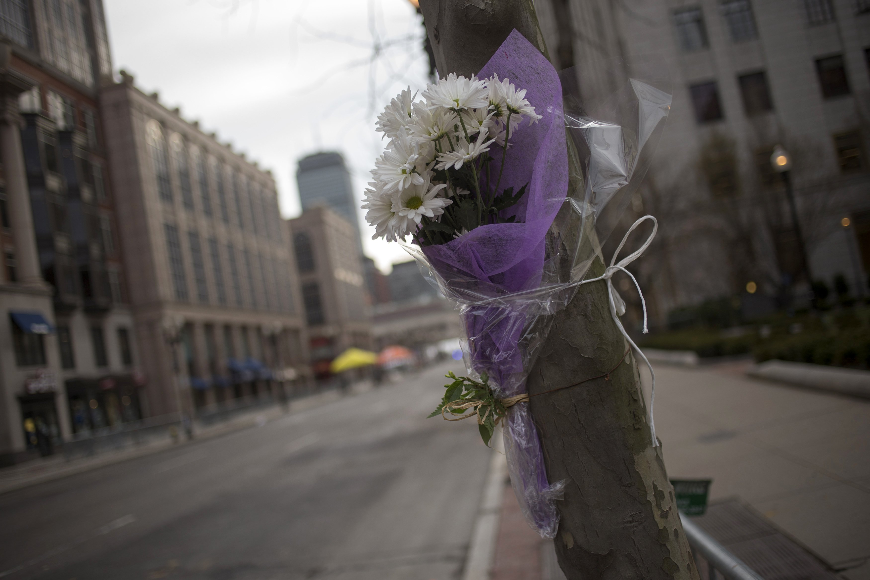 Flowers are left on Boylston Street after two explosions hit the Boston Marathon. (REUTERS)