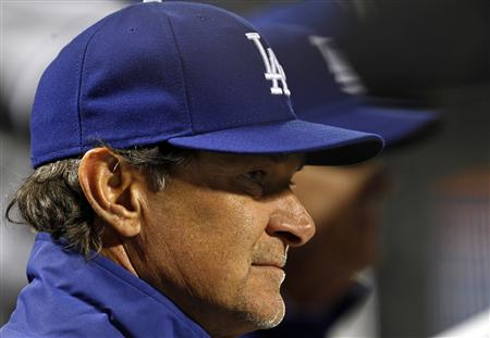 Don Mattingly and the Dodgers are in last place in the NL West. (Reuters)