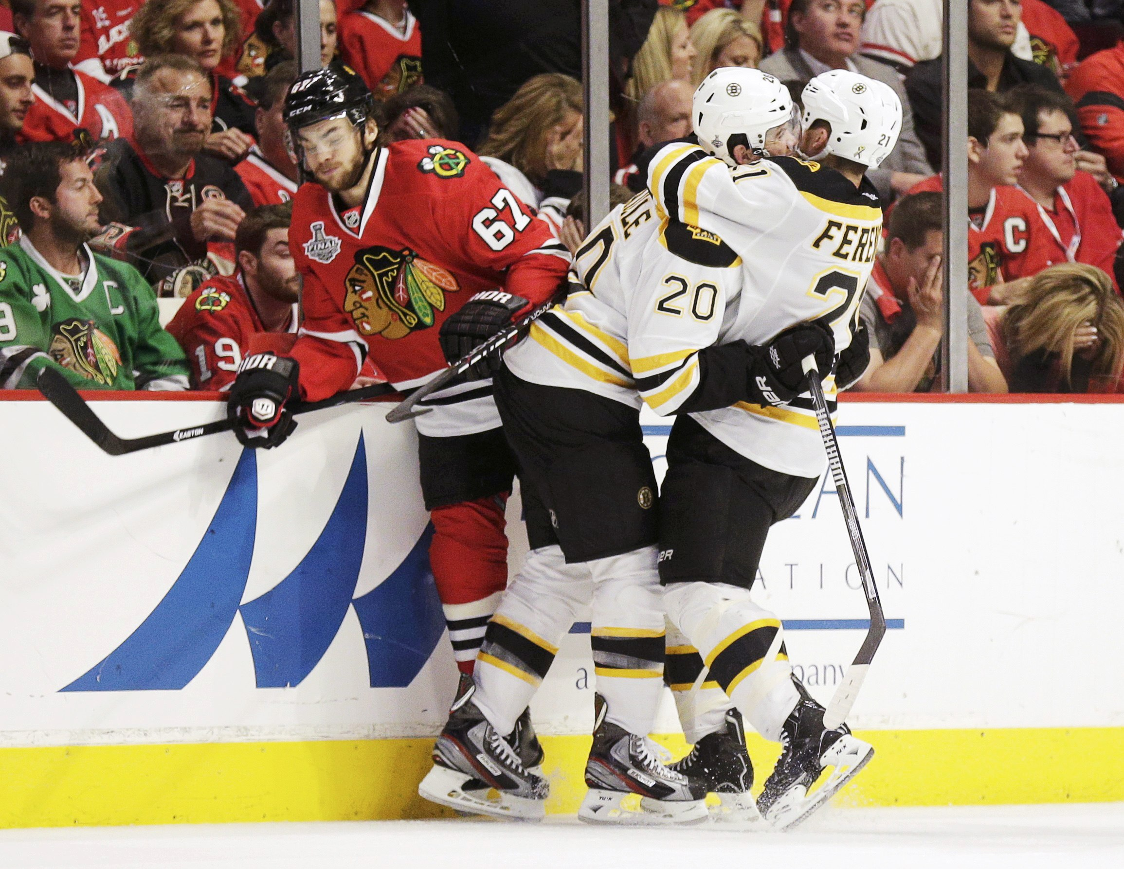 It was Boston's turn to celebrate in overtime – and Chicago's turn to grimace – in Game 2 of the Cup final. (Reuters)
