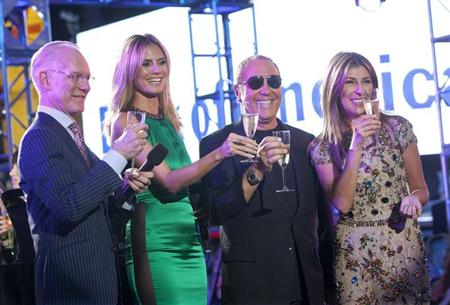 "(L-R) Tim Gunn, model Heidi Klum, designer Michael Kors and Nina Garcia propose a toast during the ""Project Runway"" 10th Anniversary Outdoor Runway Event at Times Square in New York June 15, 2012. REUTERS/ Andrew Kelly"