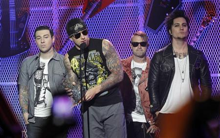 M. Shadows (2nd L) and rock band Avenged Sevenfold accept the Affliction Album of the Year award at the 3rd annual Golden Gods awards in Los Angeles April 20, 2011. REUTERS/Mario Anzuoni