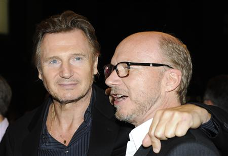 "Cast member Liam Neeson and director Paul Haggis (R) pose on the red carpet before a screening of their film ""Third Person"" at The Visa Screening Room during the 38th Toronto International Film Festival in Toronto September 9, 2013. REUTERS/Jon Blacker"