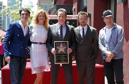 "Actor Bryan Cranston (C) poses with co-stars from his series ""Breaking Bad"" (L-R) RJ Mitte, Anna Gunn, Aaron Paul and Bob Odenkirk during ceremonies to unveil his star on the Hollywood Walk of Fame in Hollywood July 16, 2013. REUTERS/Fred Prouser"