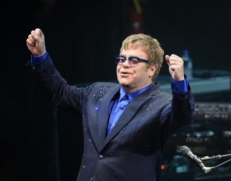"Musician Elton John performs songs off his new album ""The Diving Board"" with USC Thornton School of Music students in Los Angeles, California on September 16, 2013. REUTERS/Kevork Djansezian/Files"