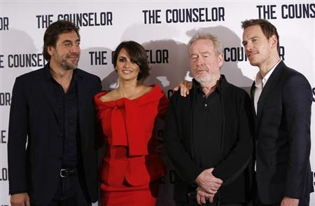 "(L-R) Actors Javier Bardem and Penelope Cruz, Director Ridley Scott and actor Michael Fassbender pose for photographers at a photocall for the film ""The Counselor"" in London October 5, 2013. REUTERS/Olivia Harris"