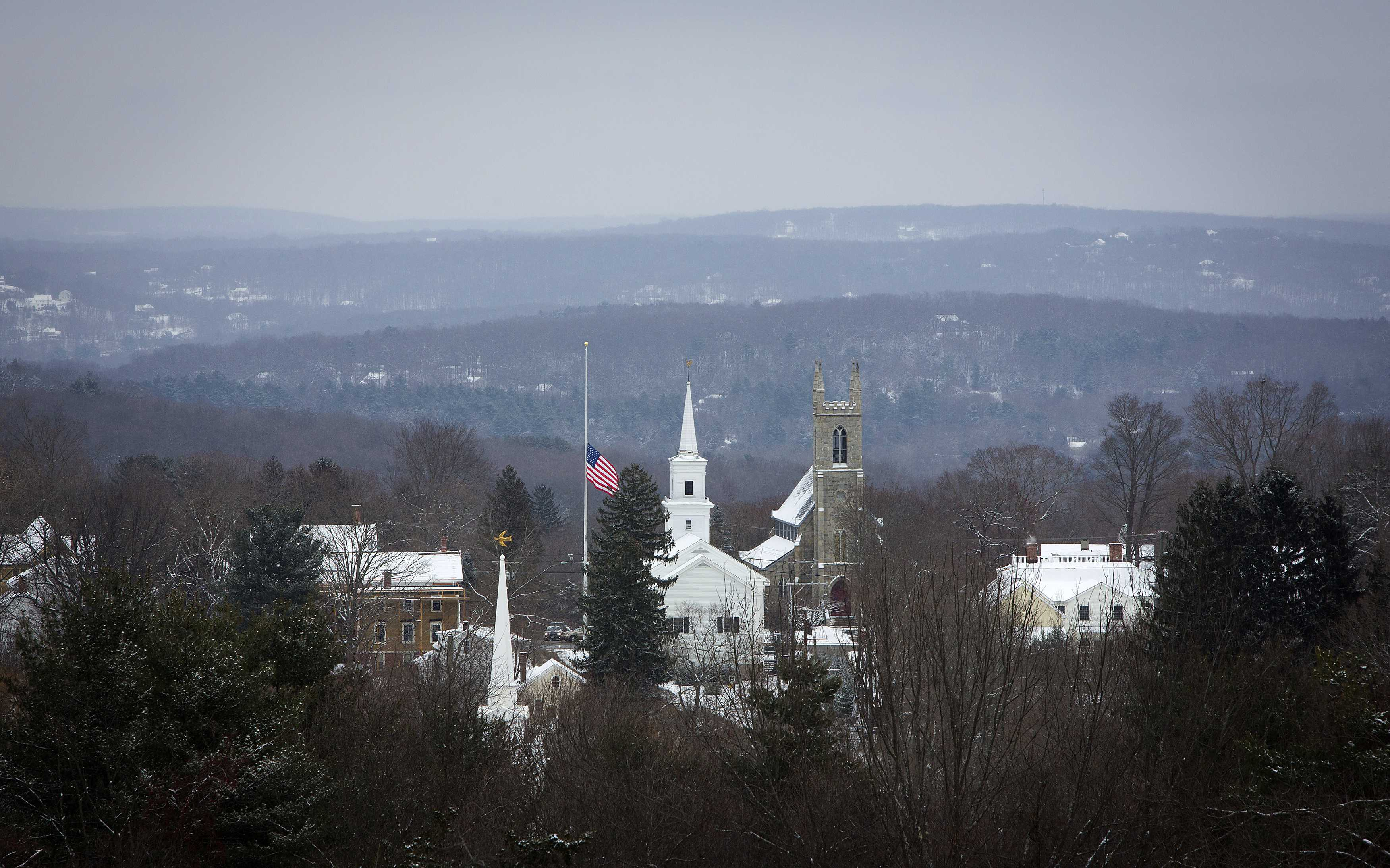 The town flag flies at half staff in Newtown, Connecticut