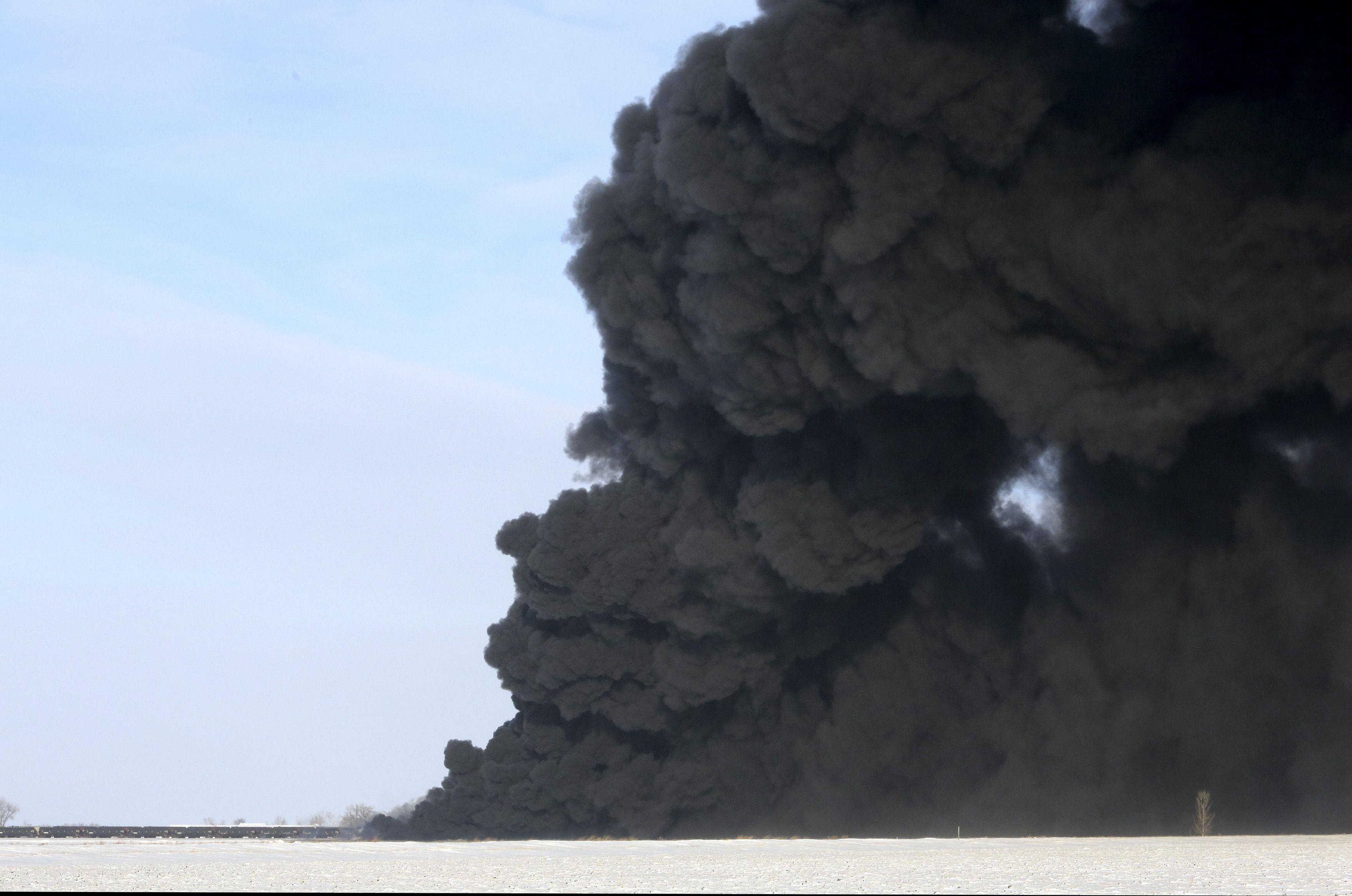 A plume of smoke rises from scene of a derailed train near Casselton, North Dakota