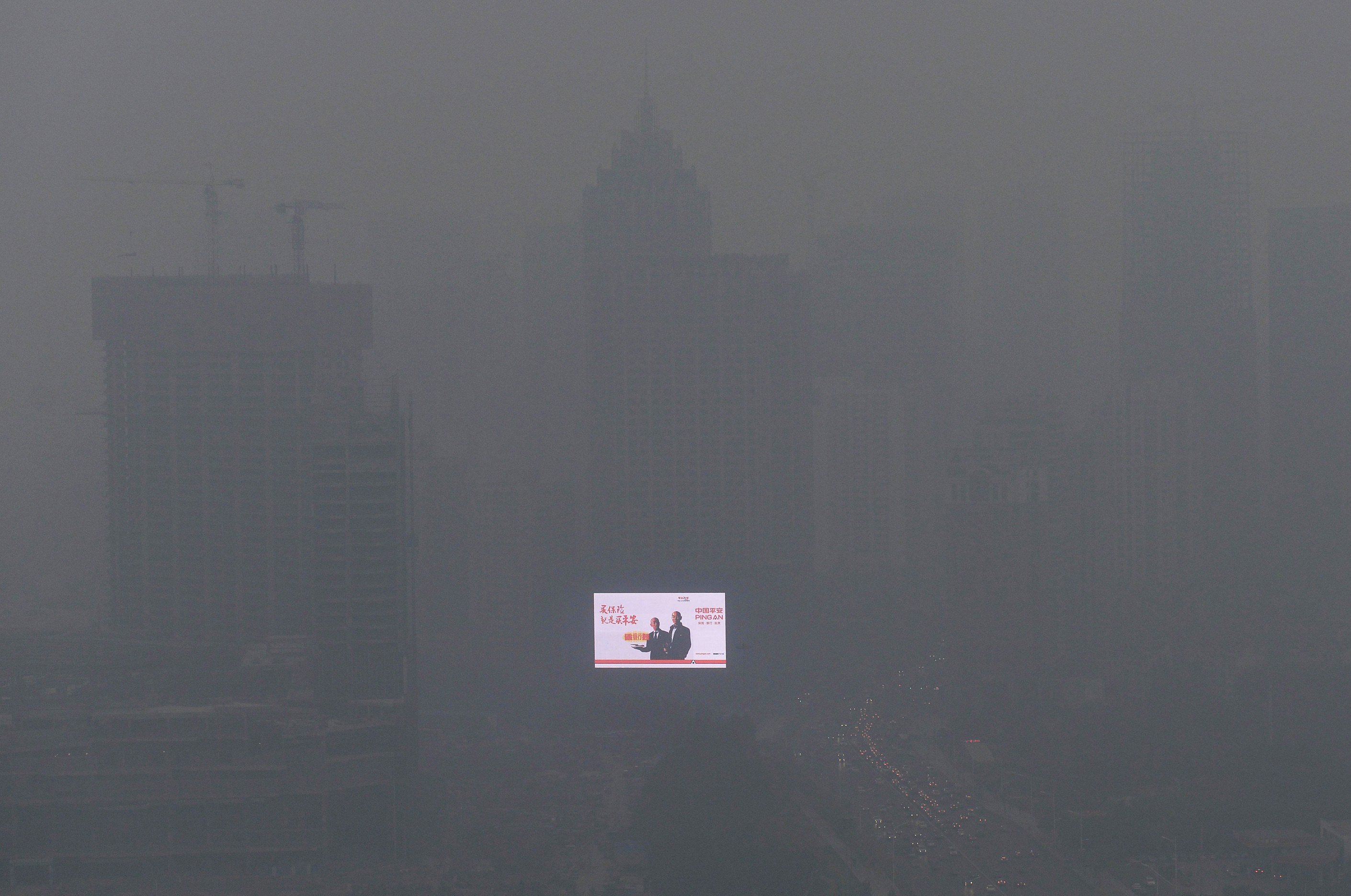 File photo of an electronic screen on a building amid heavy smog in Shenyang