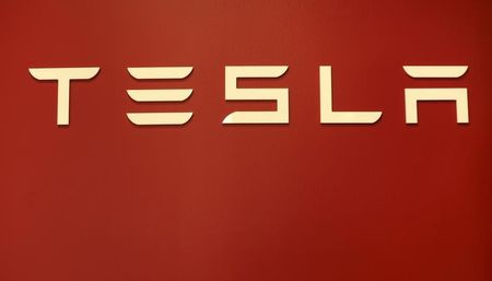 A Tesla Motors logo - Tesla Idles California Plant to Retool for Electric SUVs