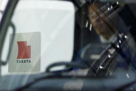 Logo of Takata Corp is seen through a car window outside the company's headquarter building in Tokyo