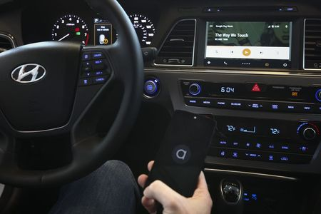 File photo of Brady demonstrating the new Android Auto…