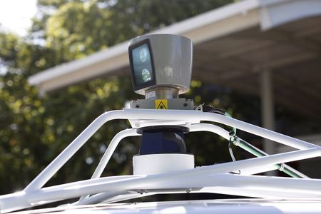 File photo of a sensor spinning atop a Google self-driving…