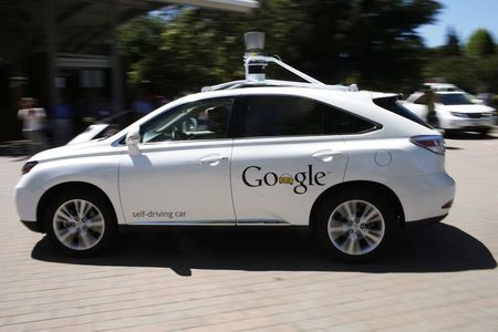 File photo of a Google self-driving vehicle driving…
