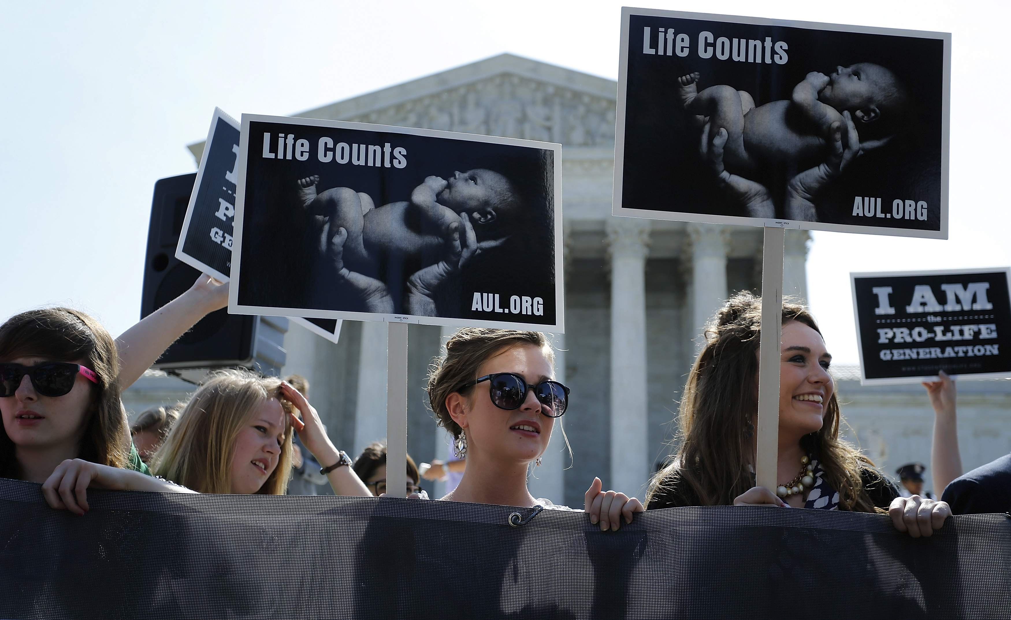 Anti-abortion demonstrators wait for the U.S. Supreme Court ruling in the Hobby Lobby case to be announced in Washington