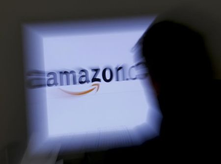 Amazon starts Netflix-style book service amid publisher spat