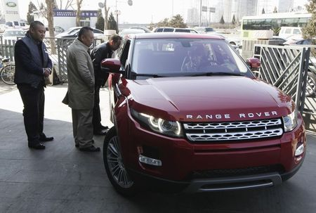 File photo of customers looking at a Range Rover Evoque …