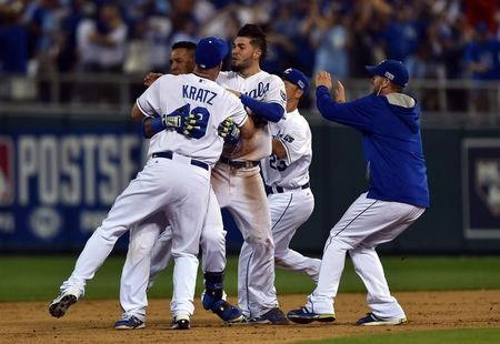 Royals slip past A's in epic 12-inning AL wild-card game