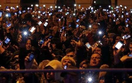 Hungary's Orban puts Internet tax on hold after huge protests