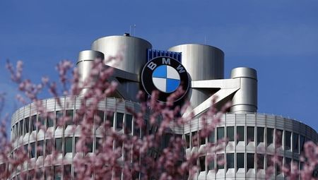 Trees bloom in front of the headquarters of German luxury car maker BMW in Munich