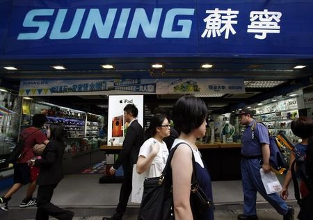 Mega retailers battle to survive as e-commerce booms in China
