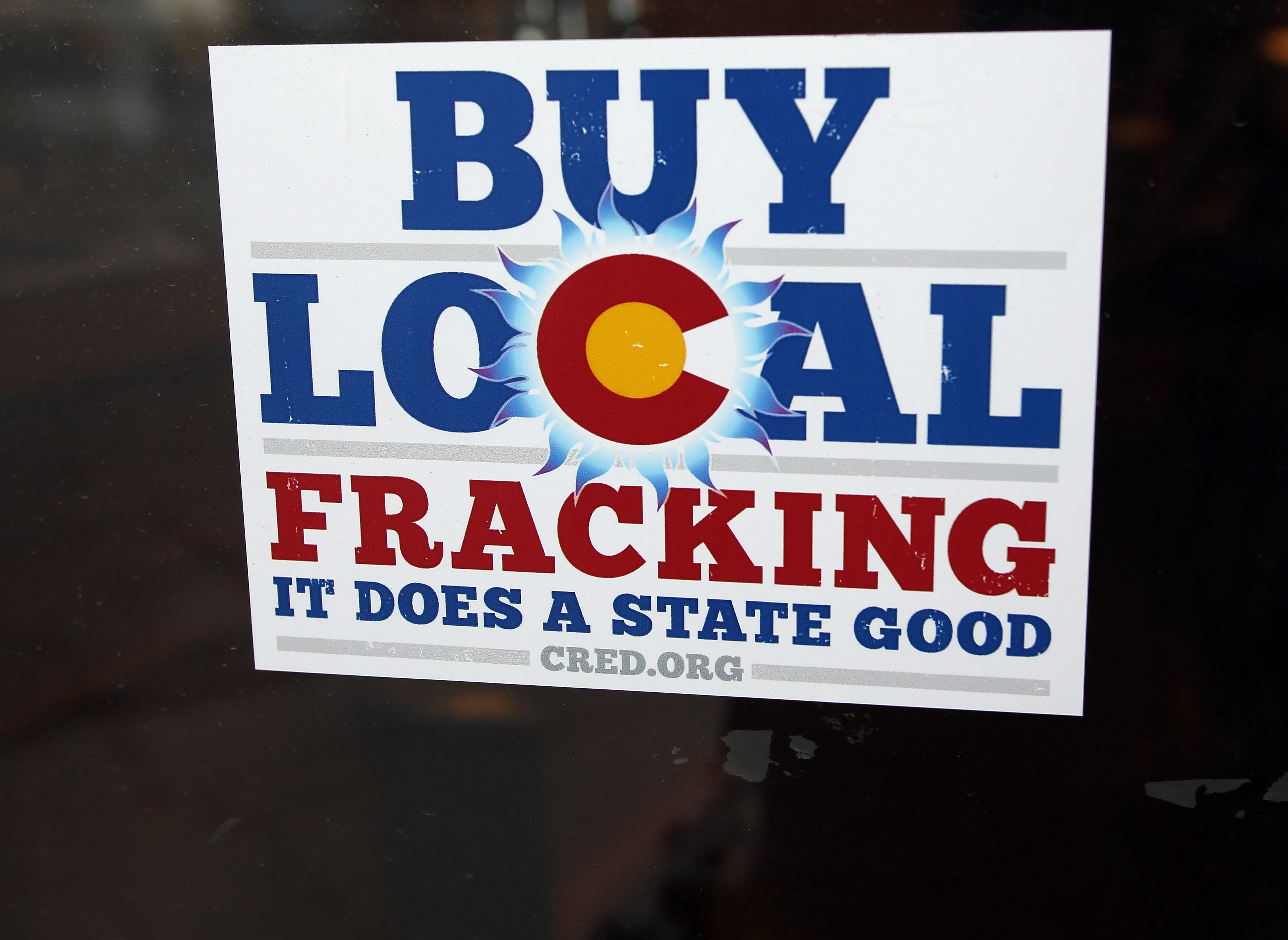 A sign supporting fracking on the doorway at Mama's Restaurant in Parachute, Colorado
