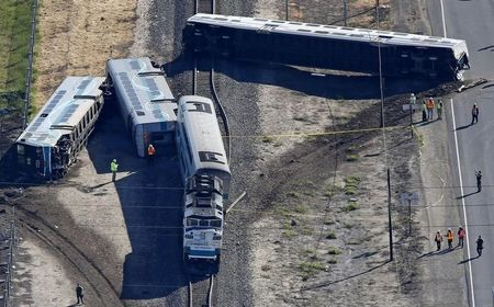 Driver of truck hit by California train released from custody