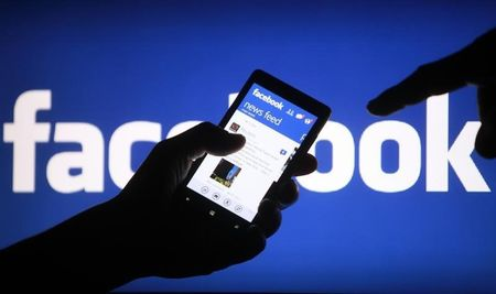 Facebook revenue growth slows, costs weigh on profit