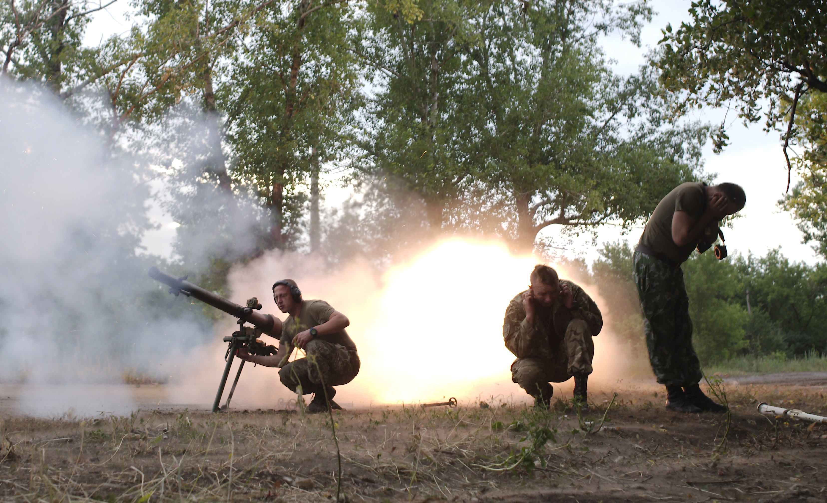 Members of the Ukrainian armed forces fire a grenade launcher in Avdiivka