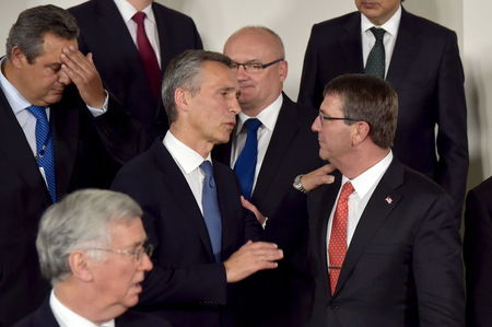 U.S., eyeing Russia, urges NATO allies to harden cyber defenses