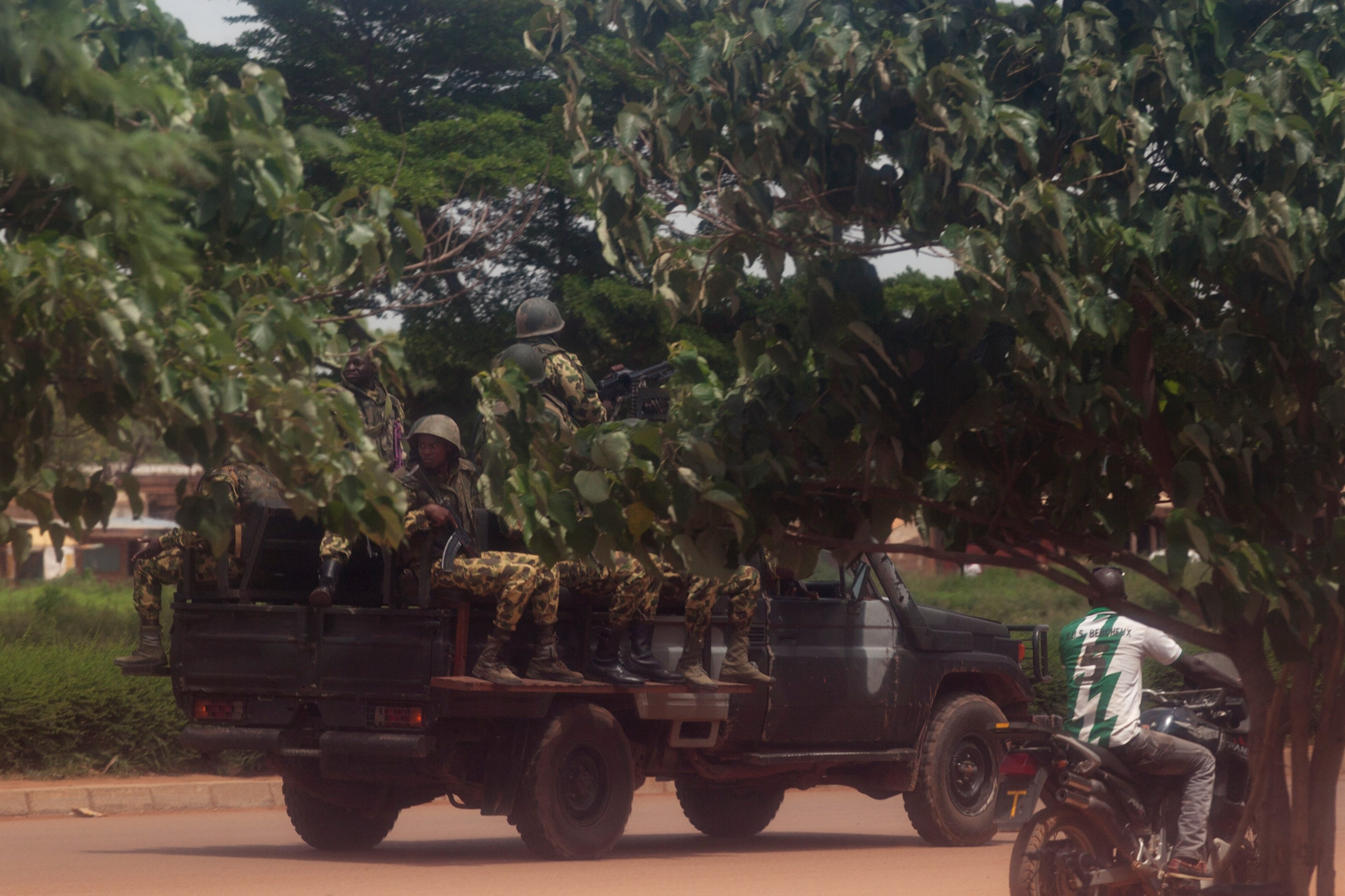 Members of the presidential guard look for protesters in Ouagadougou