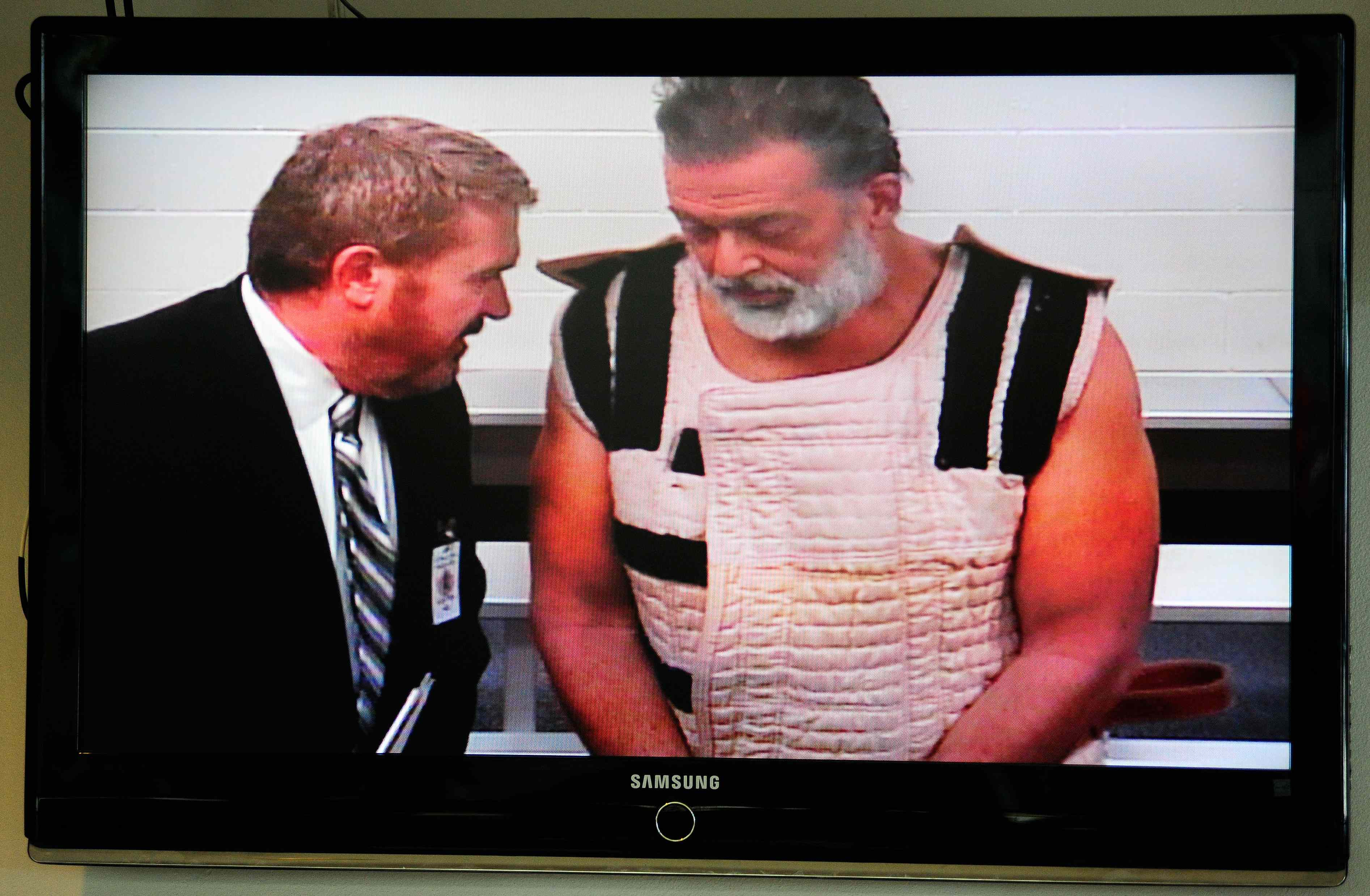 Accused Planned Parenthood gunman Robert Lewis Dear (R) appears in court with public defender Dan King by video link from jail in Colorado Springs