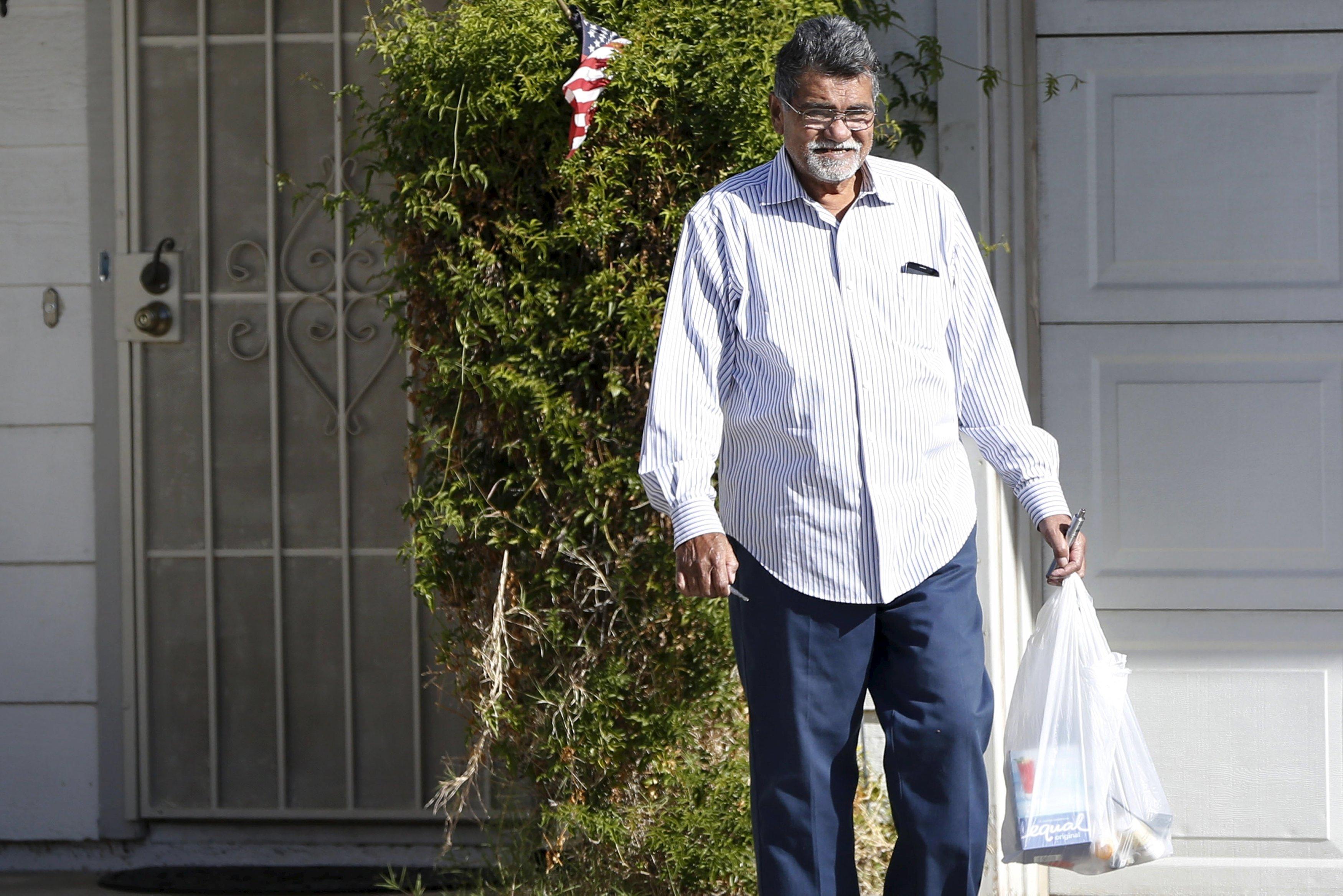 Syed Farook, father of San Bernardino shooting suspect Syed Rizwan Farook, leaves a residence in Riverside