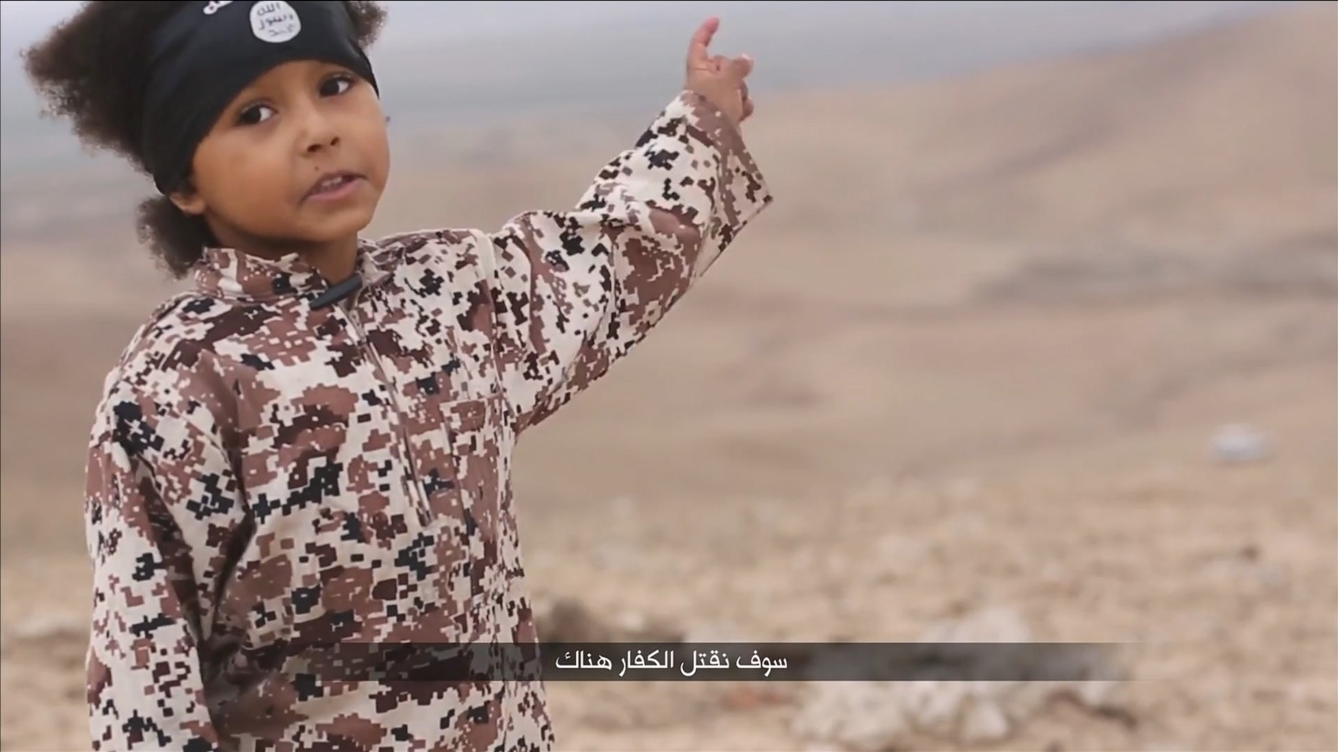 A child speaks in this still image from a handout video obtained from a social media website which has not been independently verified
